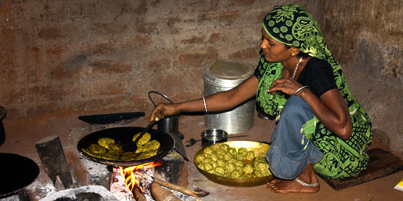 A woman in the process of cooking, Gujarat, India