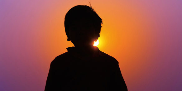 Boy and sunset, India