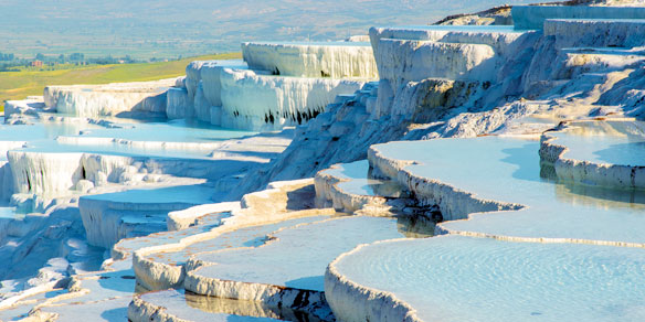 Enchanting Pools, hot springs and travertine, terraces of solidified calcium, UNESCO World Heritage Site, Pamukkale, Turkey