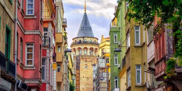 Galata Tower with colourful houses in the Old Town of Balat, Istanbul, Turkey